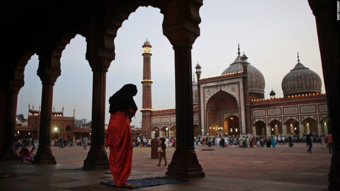 A woman prays after breaking her fast in New Delhi on June 7.