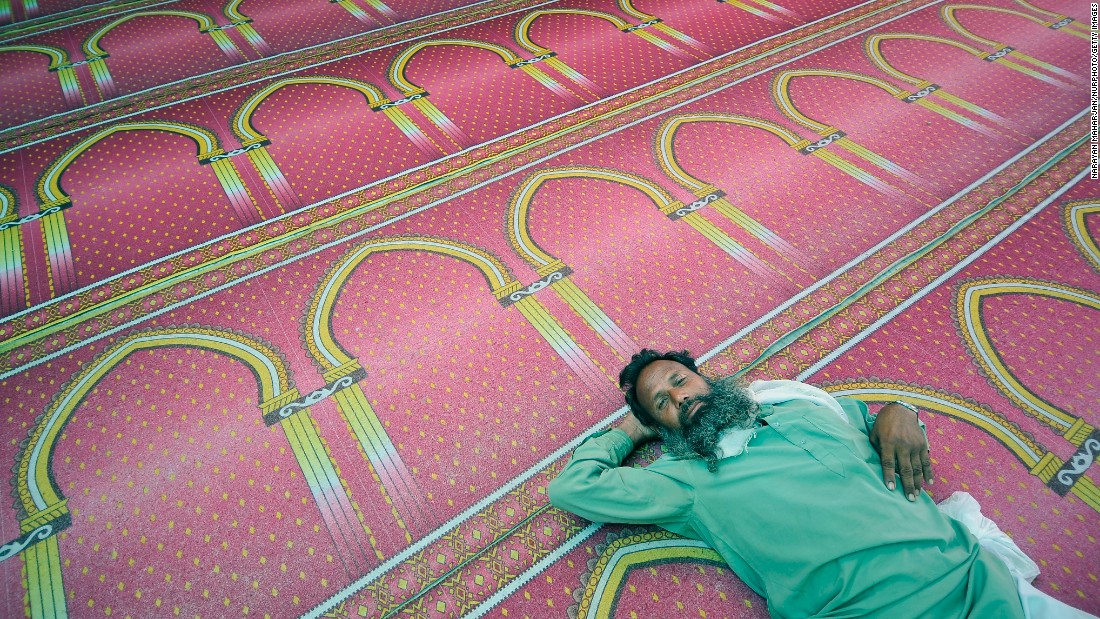 A man rests at a mosque in Kathmandu, Nepal, on June 9.