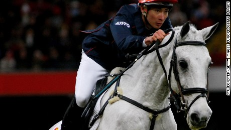CARDIFF, UNITED KINGDOM - NOVEMBER 30:  Rider Alex Hua Tian riding 'FBW Chico' clears a fence during the Express Eventing International Cup at the Millennium Stadium on November 30, 2008 in Cardiff, Wales.  (Photo by Stu Forster/Getty Images)