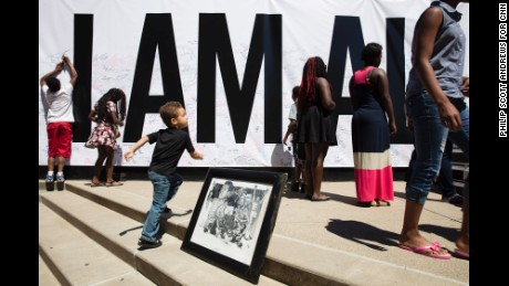 "An ""I Am Ali"" poster covered an entire wall at the Kentucky Center in Louisville on Wednesday, June 8. A downtown festival celebrated the life of the legendary boxer Muhammad Ali, who died Friday at 74. (Philip Scott Andrews for CNN)"