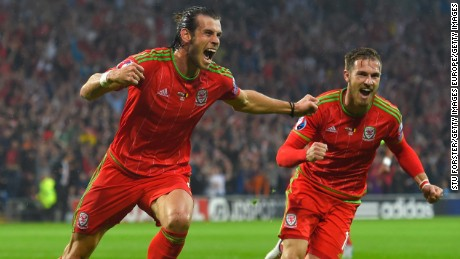 CARDIFF, WALES - JUNE 12:  Wales player Gareth Bale celebrates after scoring the opening goal during the UEFA EURO Group B 2016 Qualifier between Wales and Belguim at Cardiff City stadium on June 12, 2015 in Cardiff, United Kingdom.  (Photo by Stu Forster/Getty Images)