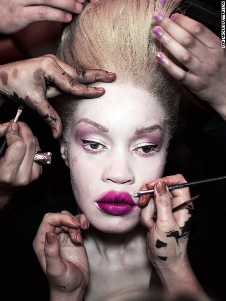 African-American model Diandra Forrest has her make-up and hair done before a show during the South Africa Fashion Week, Johannesburg 2012