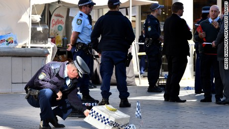 Officers investigate the scene of a police shooting at the shopping arcade in the Hornsby area of Sydney on June 9, 2016.  Three elderly bystanders were wounded on June 9 when Australian police opened fire on a man wielding a large carving knife in a busy Sydney shopping centre, authorities said. / AFP / SAEED KHAN        (Photo credit should read SAEED KHAN/AFP/Getty Images)