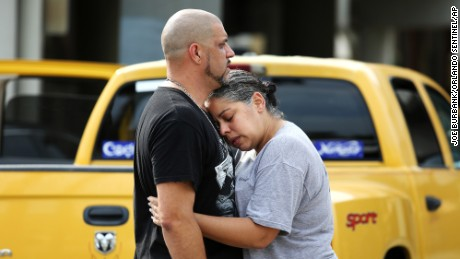Ray Rivera, a DJ at Pulse Orlando nightclub, is consoled by a friend outside of the Orlando Police Department after a shooting that killed at least 50 people and injured 53 on Sunday, June 12.