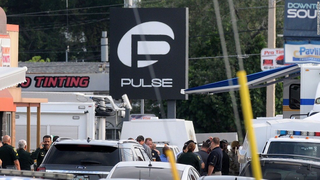 "Police officers gather outside of the nightclub, which describes itself as ""the hottest gay bar"" in the heart of Orlando."