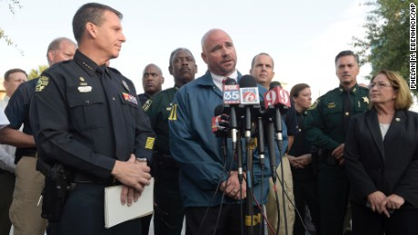 FBI assistant special agent in charge Ron Hopper, center, answers questions from members of the media. Listening are Orlando Police Chief John Mina, left, and Orange County Mayor Teresa Jacobs.
