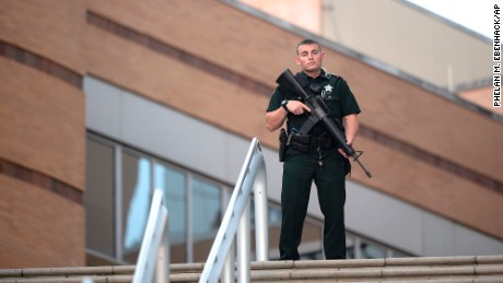 A police officer stands guard outside the Orlando Regional Medical Center hospital after the mass shooting at the Pulse Orlando nightclub.