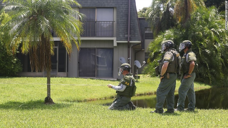 A bomb disposal unit checks for explosives around the apartment building where shooting suspect Omar Mateen is believed to have lived in Fort Pierce, Florida.