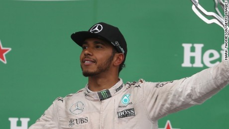 Lewis Hamilton celebrates winning the Canadian F1 Grand Prix for the fifth time.