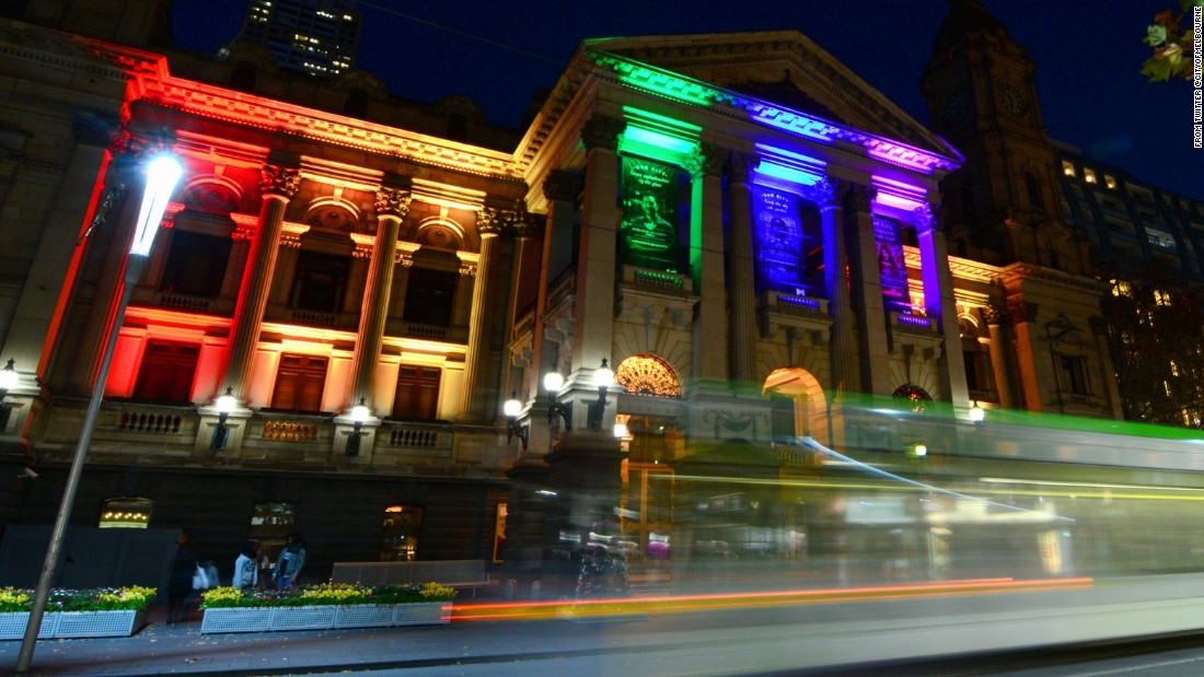 "The city of Melbourne posted this image on its Twitter account June 13 ""as a mark of respect for those touched by the attack in Orlando. Town Hall is lit in the rainbow #LoveIsLove."""