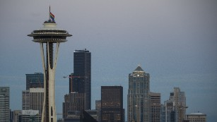 A rainbow flag flies at half mast on the Space Needle in Seattle, Washington on June 12, in honor of the victims of the nightclub shooting in Orlando.