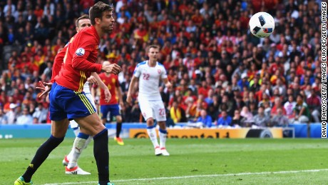 Pique headed home Iniesta's cross to secure victory for Spain.