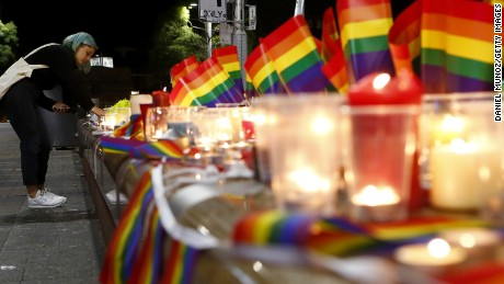 SYDNEY, AUSTRALIA - JUNE 13:  A woman lights a candle during a candlelight vigil for the victims of the Pulse Nightclub shooting in Orlando, Florida, at Oxford St on June 13, 2016 in Sydney, Australia. 50 people were killed and 53 injured after a gunman opened fire on people in a gay nightclub in Florida. It is the deadliest mass shooting in US history.  (Photo by Daniel Munoz/Getty Images)