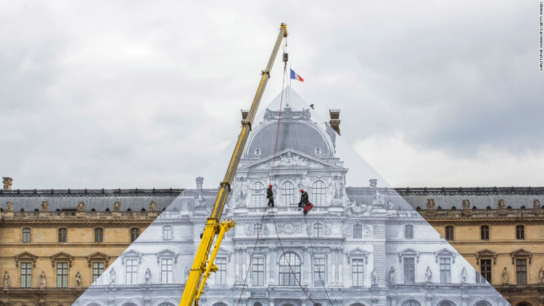 "French street artist JR's latest installation sees the Paris Louvre ""disappear"" under a trompe l'oeil photographic collage. The work is open to the public until June 27, 2016. <br />"