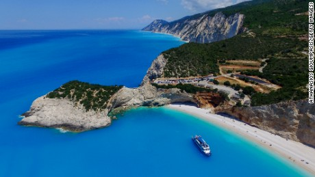 LEFKADA, GREECE - JUNE 08: Aerial view of Porto Katsiki beach on June 08, 2016 in Lefkada,Greece. Porto Katsiki beach on Lefkada Island is one of the most beautiful Greek beaches. It is also in the top of the list of best beaches in Europe each year. Locatred 40 kilometers southwest of Lefkada Town. Porto Katsiki beach surrounded by incredible hills which make it accessible only by 80 steep steps descending along the cliff. This is one of the most favorite beaches and it is considered to be one of the island's major attractions. Porto Katsiki owes its fame to fascinating landscape with crystal clear blue sea and golden sandy beach. (Photo by Athanasios Gioumpasis/Getty Images)