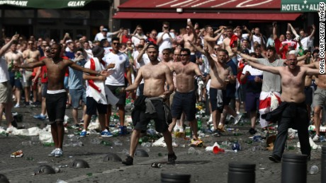 England fans throw bottles and clash with police ahead of the game against Russia on Saturday in Marseille, France.