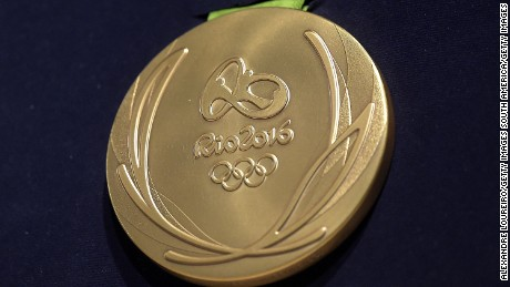 RIO DE JANEIRO, BRAZIL - JUNE 14: A close-up of the Olympic gold medal during the Launch of Medals and Victory Ceremonies for the Rio 2016 Olympic and Paralympic Games at the Future Arena in Olympic Park on June 14, 2016 in Rio de Janeiro, Brazil. (Photo by Alexandre Loureiro/Getty Images)