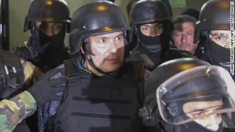 Argentinian former Vice Minister of Public Works (2003-2015) and current Parlasur deputy Jose Lopez (C) is taken into custody after being arrested in General Rodriguez, province of Buenos Aires on June 14, 2016 while he was trying to hide 160 packages with more than eight million dollars in the garden of a nunnery. / AFP / Noticias Argentinas / JUAN VARGAS        (Photo credit should read JUAN VARGAS/AFP/Getty Images)