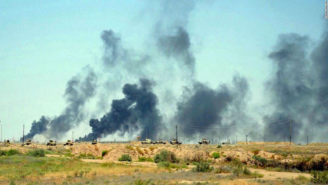 Smoke rises after airstrikes by U.S.-led coalition warplanes on Sunday, June 12.