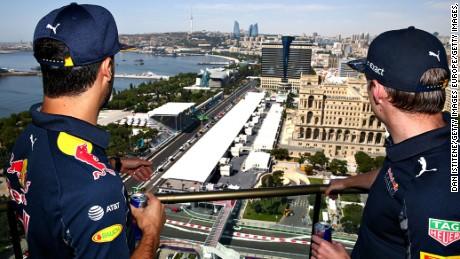 Red Bull Racing's Daniel Ricciardo and Max Verstappen look down on the Baku City Circuit