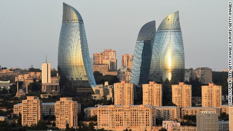 The Sun rise is reflected in The Flame Towers on August 4, 2014 in Baku, Azerbaijan.  (Photo by Christopher Lee/Getty Images)
