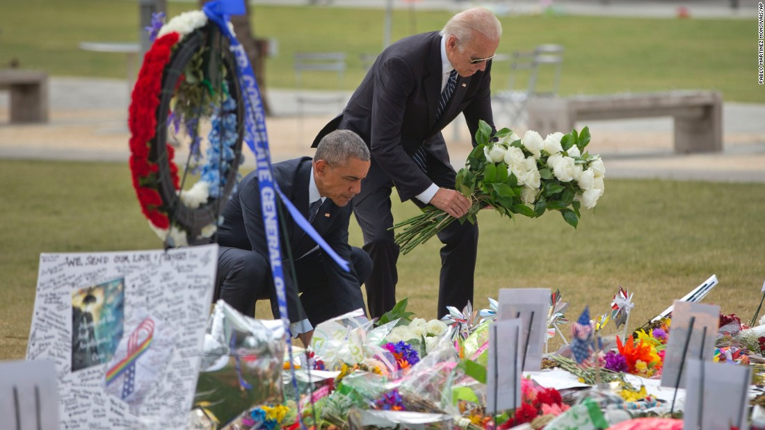 "President Obama and Vice President Joe Biden place flowers at a memorial on Thursday, June 16, for the victims of the nightclub shooting in Orlando. At least 49 people <a href=""http://www.cnn.com/2016/06/12/us/gallery/orlando-shooting/index.html"" target=""_blank"">were killed in the massacre,</a> the deadliest mass shooting in U.S. history."