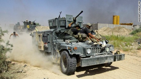 Iraqi security forces evacuate an injured soldier during heavy fighting against Islamic State militants in Fallujah, Iraq, Wednesday, June 15, 2016. Fallujah has been locked in a cycle of conflict since 2003, when it emerged as a bastion of the insurgency against the Americans. Militant attacks and bombings were followed by sweeping arrest raids, which further stoked local grievances. In 2004, U.S. troops launched two massive assaults on the city, where they fought their bloodiest battles since Vietnam. (AP Photo/Anmar Khalil)
