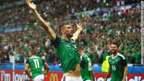 LYON, FRANCE - JUNE 16:  Gareth McAuley (C) of Northern Ireland celebrates scoring his team's first goal during the UEFA EURO 2016 Group C match between Ukraine and Northern Ireland at Stade des Lumieres on June 16, 2016 in Lyon, France.  (Photo by Clive Brunskill/Getty Images)