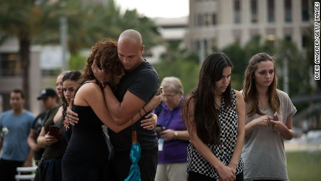 A couple embraces as they visit   a memorial for the victims of the Pulse Nightclub shooting, at the Dr. Phillips Center for Performing Arts, June 14, 2016 in Orlando, Florida.