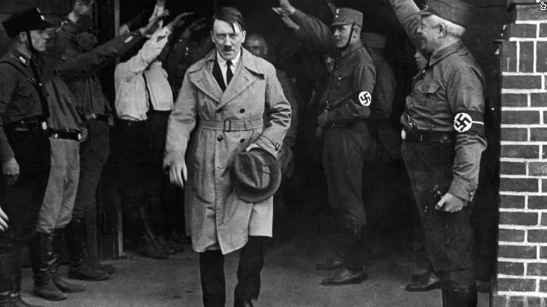 Hitler, then leader of the National Socialists, leaves the party's Munich headquarters in December 1931.