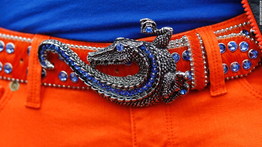 A fan wears an alligator belt buckle during a University of Florida football game in 2013. The university's sports teams are called the Gators.