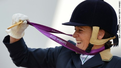 Australia's Joann Formosa receives the gold medal in the Individual Championship Test - Grade 1b Final at the London 2012 Paralympic Games in Greenwich Park in London, on September 1, 2012. AFP PHOTO / BEN STANSALL        (Photo credit should read BEN STANSALL/AFP/GettyImages)