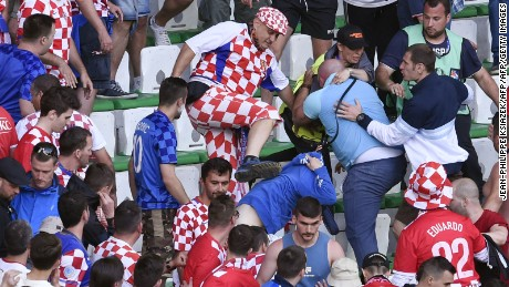 Croatia fans fight during the Euro 2016 group D football match between Czech Republic and Croatia at the Geoffroy-Guichard stadium in Saint-Etienne on June 17, 2016. Czech Republic and Croatia drew 2-2. / AFP / JEAN-PHILIPPE KSIAZEK        (Photo credit should read JEAN-PHILIPPE KSIAZEK/AFP/Getty Images)