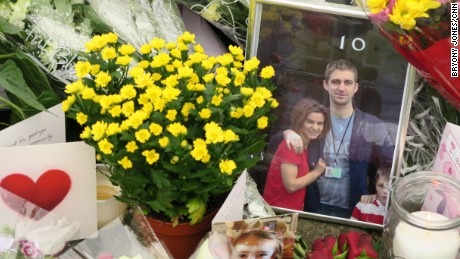 A photo of slain MP Jo Cox and her husband outside the British Prime Minister's residence lies amid floral tributes in Birstall, the northern English town where she was killed.