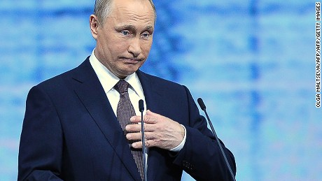 Russian President Vladimir Putin gives a speech at a session of the St. Petersburg International Economic Forum.