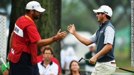 OAKMONT, PA - JUNE 17:  Andrew Landry of the United States shakes hands with his caddie Kevin Ensor prior to the start of play during the continuation of the weather delayed first round of the U.S. Open at Oakmont Country Club on June 17, 2016 in Oakmont, Pennsylvania.  (Photo by Ross Kinnaird/Getty Images)