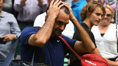 A dejected Roger Federer walks off after his semifinal defeat at Halle toAlexander Zverev of Germany.