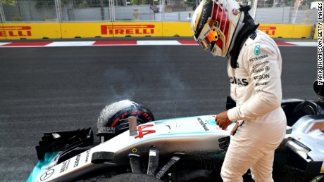 Lewis Hamilton walks away after crashing his Mercedes into the wall on the Baku circuit in final qualifying for the European Grand Prix.