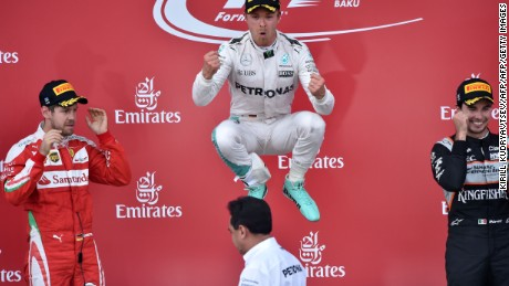 Winner Mercedes AMG Petronas F1 Team's German driver Nico Rosberg (C) celebrates next to second placed Scuderia Ferrari's German driver Sebastian Vettel (L) and third placed Sahara Force India F1 Team's Mexican driver Sergio Perez after the European Formula One Grand Prix at the Baku City Circuit on June 19, 2016 in Baku.  / AFP / KIRILL KUDRYAVTSEV        (Photo credit should read KIRILL KUDRYAVTSEV/AFP/Getty Images)