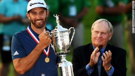 Dustin Johnson of the United States holds the winner's trophy alongside Jack Nicklaus after winning the U.S. Open at Oakmont Country Club on Sunday, June 19 in Oakmont, Pennsylvania.