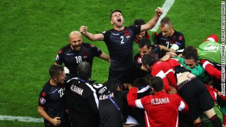 Albania players celebrate Sadiku's goal