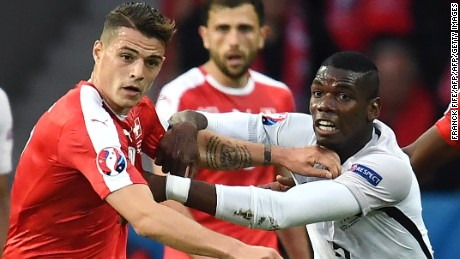 Switzerland's midfielder Granit Xhaka (L) vies for the ball against France's midfielder Paul Pogba during the Euro 2016 group A football match between Switzerland and France at the Pierre-Mauroy stadium in Lille on June 19, 2016. / AFP / FRANCK FIFE        (Photo credit should read FRANCK FIFE/AFP/Getty Images)