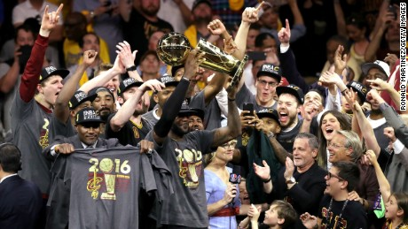 OAKLAND, CA - JUNE 19:  LeBron James #23 of the Cleveland Cavaliers holds the Larry O'Brien Championship Trophy after defeating the Golden State Warriors 93-89 in Game 7 of the 2016 NBA Finals at ORACLE Arena on June 19, 2016 in Oakland, California. NOTE TO USER: User expressly acknowledges and agrees that, by downloading and or using this photograph, User is consenting to the terms and conditions of the Getty Images License Agreement.  (Photo by Ronald Martinez/Getty Images)