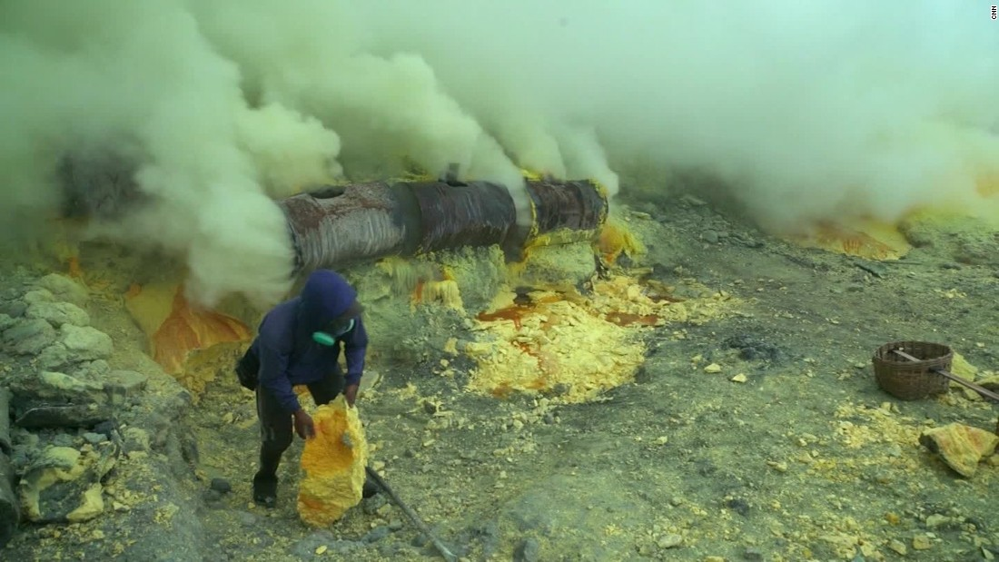 The chalky mineral builds up around vents that belch out yellow smoke from inside the volcano.