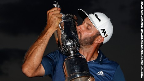 OAKMONT, PA - JUNE 19:  Dustin Johnson of the United States kisses the winner's trophy after his victory at the U.S. Open at Oakmont Country Club on June 19, 2016 in Oakmont, Pennsylvania.  (Photo by Christian Petersen/Getty Images)