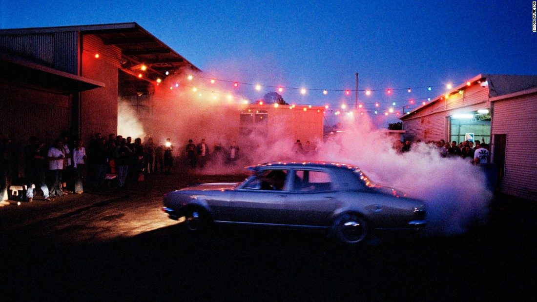 He is also famous for his series of photos of Australian burnouts -- which is when a stationery car spins its wheels so fast that the tires heat up and create smoke.