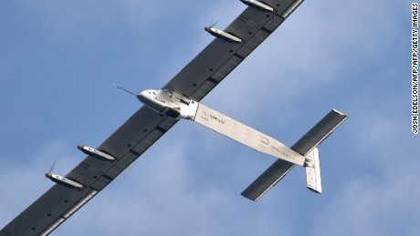 Solar Impulse 2, piloted by Bertrand Piccard, flies above San Francisco before a scheduled landing at Moffett Field NASA Ames Research Center in Mountain View, California on April 23, 2016.  Solar Impulse 2 is attempting to be the first solar-powered airplane to fly around the world without using fuel. / AFP / Josh Edelson        (Photo credit should read JOSH EDELSON/AFP/Getty Images)