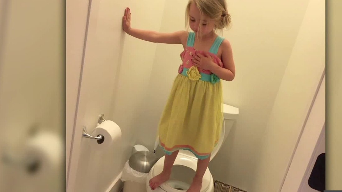 Girl stands on toilet as part of preschool gun drill