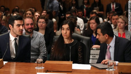 Nadia Murad, center, human rights activist, testifies during Senate Homeland Security and Governmental Affairs Committee hearing on Capitol Hill, June 21, 2016 in Washington, DC.