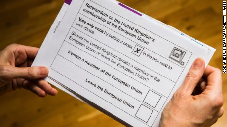 A British national receives her postal ballot paper, on May 30, 2016 in Berlin for the upcoming EU referendum scheduled for June 23.